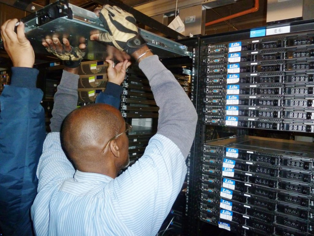 Lile movers lifting servers from a server room