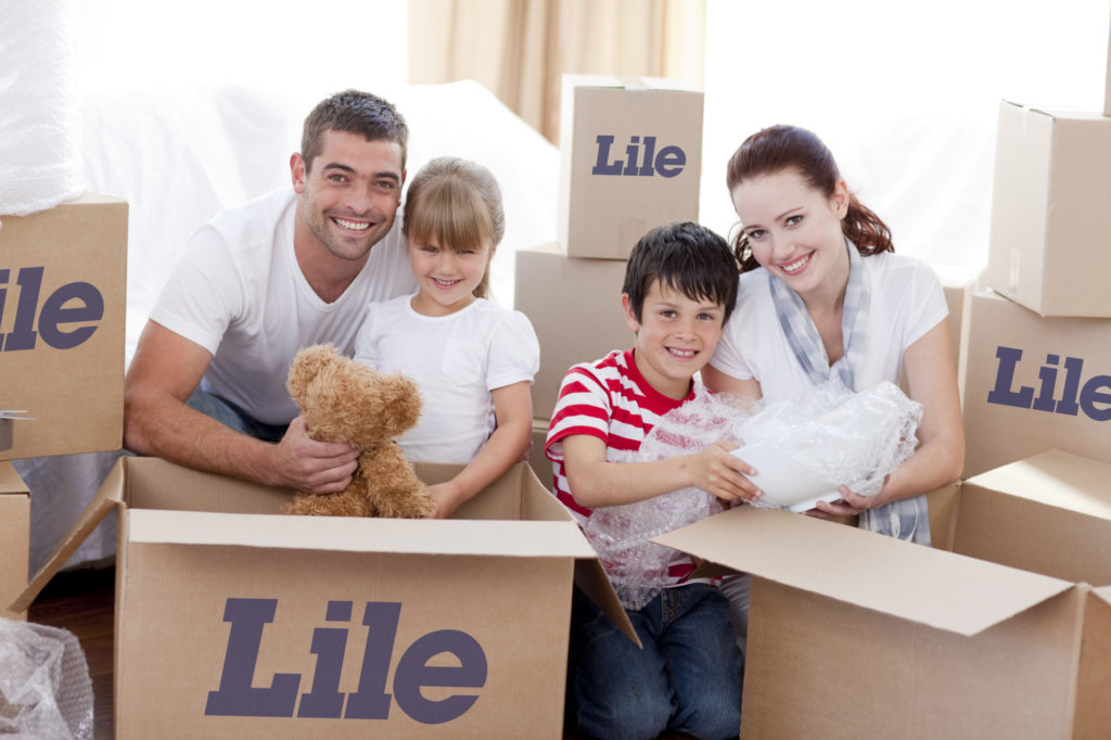 Family Packing Lile moving boxes