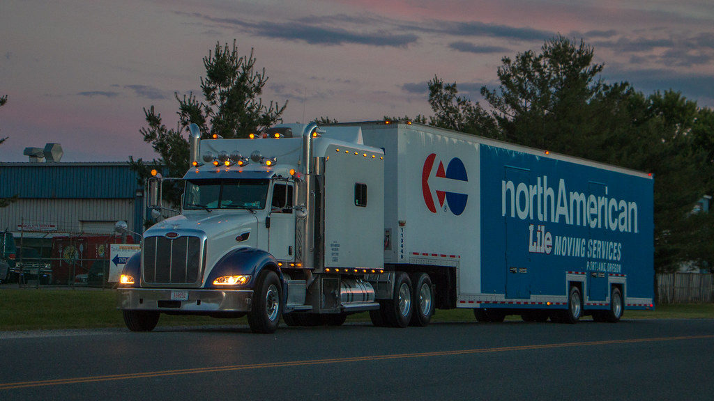 Lile moving and storage services truck at night