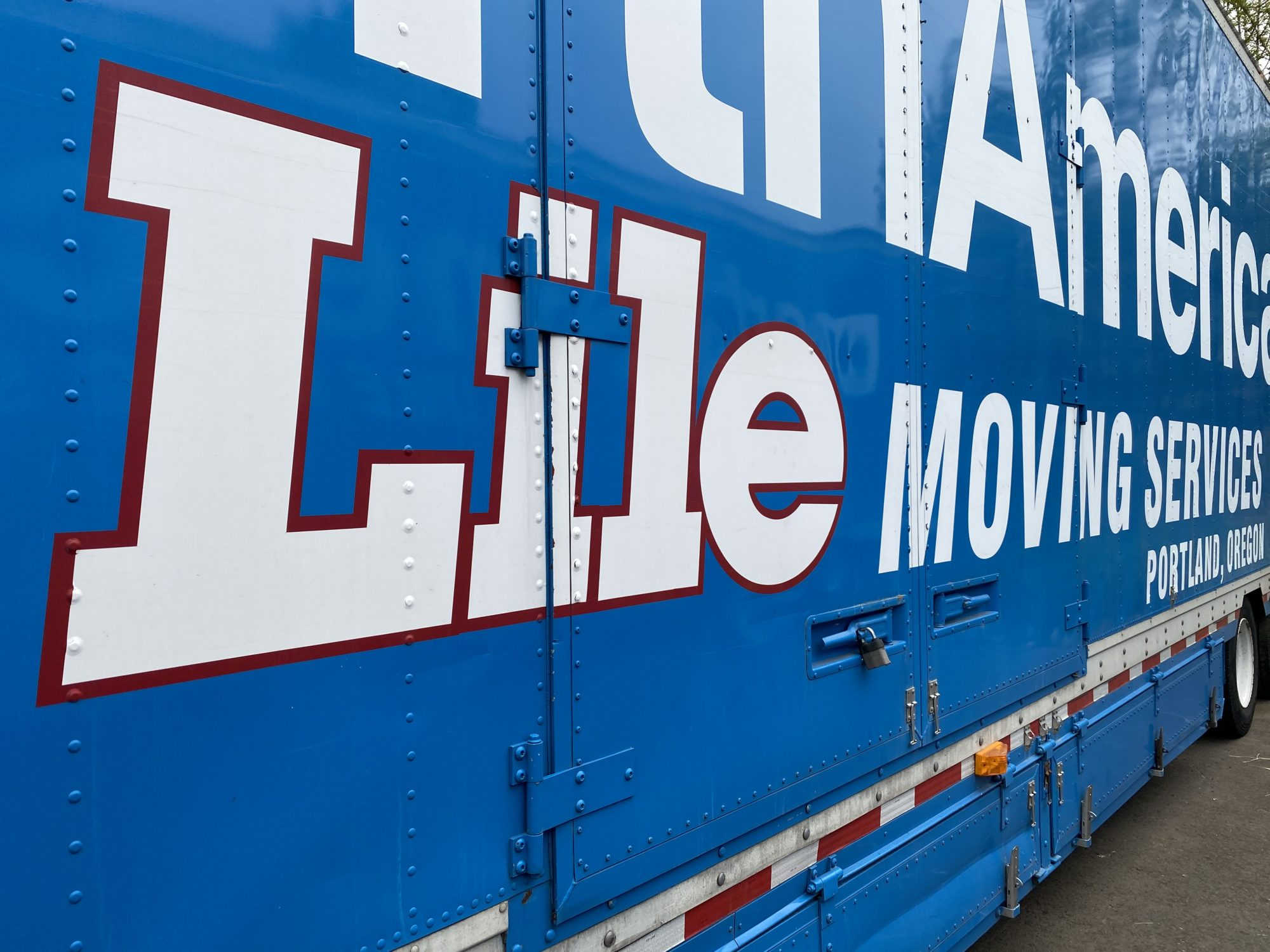 The side of a Lile moving services company truck trailer