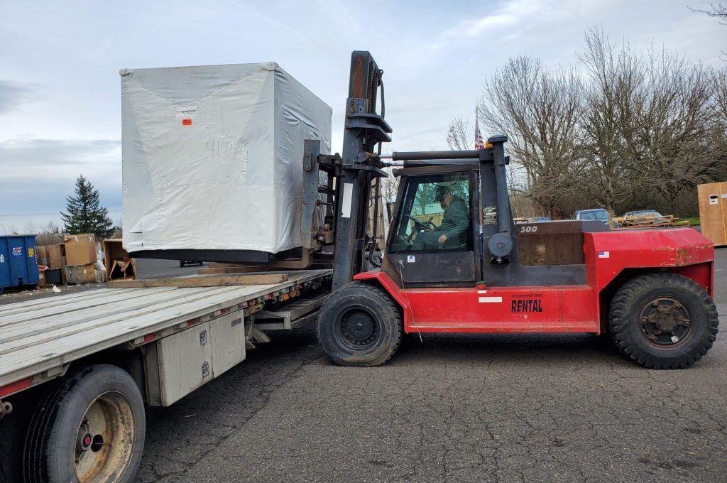 large item being dropped off at Portland warehouse
