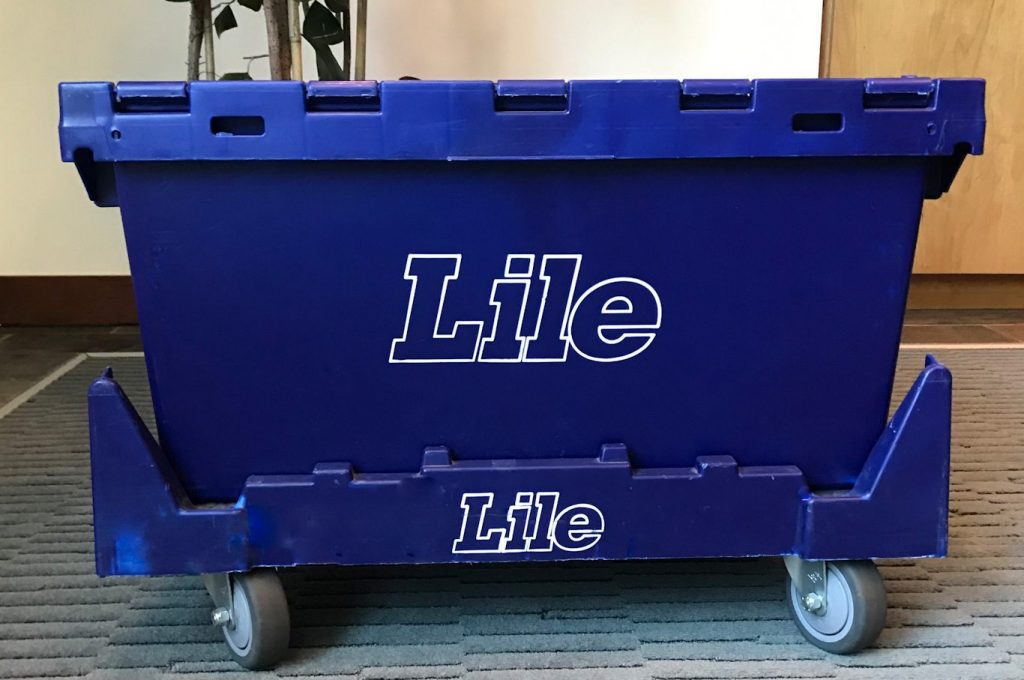 The side of a blue Lile commercial moving e-crate