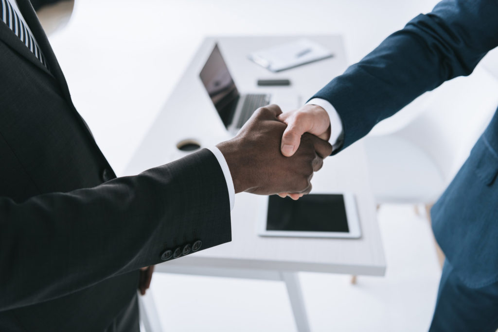 Men shaking hands making a commitment