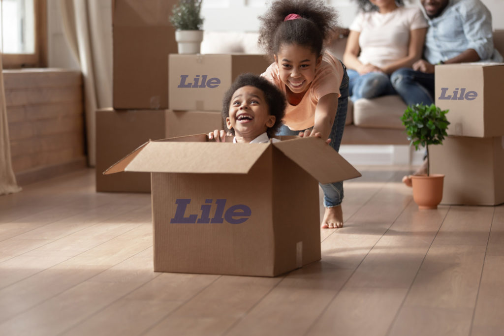 kids playing in moving boxes